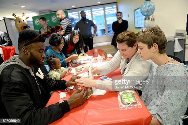 Boston Celtics Jaylen Brown builds a ginger bread house with Landonn and Mom at Boston Children's Hospital on December 1 2016 in Boston Massachusetts