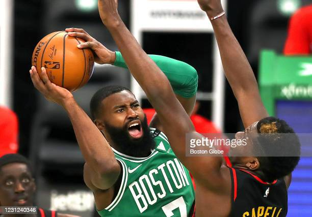 Boston Celtics Jaylen Brown drives for the basket over Atlanta Hawks' Clint Capela, scoring two points in the third quarter. The Boston Celtics host...