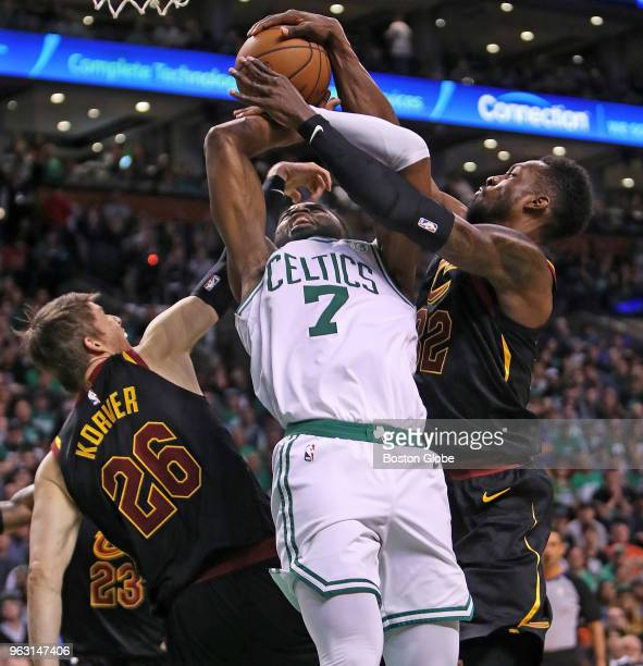 Boston Celtics Jaylen Brown is tied up by the Cavaliers Kyle Korver and Jeff Green which resulted in a jump ball in the first half The Boston Celtics...