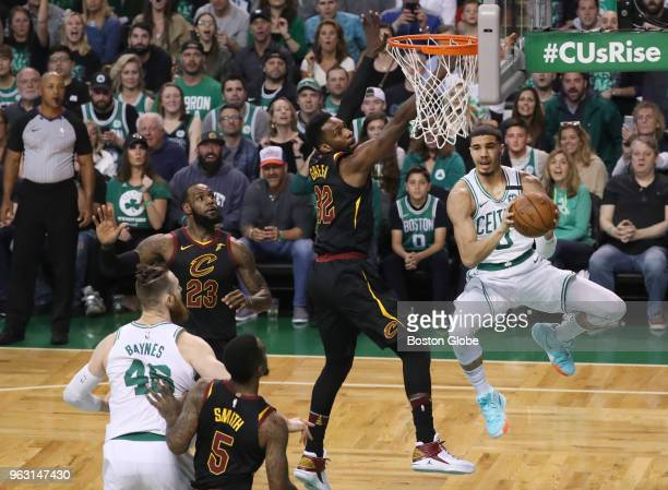 Boston Celtics Jayson Tatum looks to pass with defensive pressure from Cleveland Cavaliers Jeff Green during first quarter action The Boston Celtics...