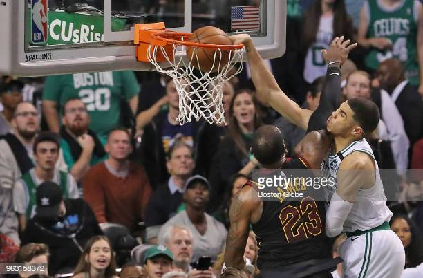 Boston Celtics Jayson Tatum scores on a slam dunks on Cleveland Cavaliers LeBron James during fourth quarter action The Boston Celtics hosted the...