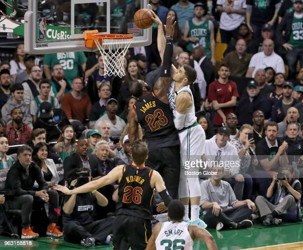 Boston Celtics Jayson Tatum slam dunks over Cleveland Cavaliers LeBron James during fourth quarter action The Boston Celtics hosted the Cleveland...