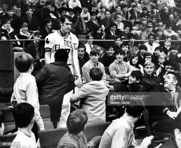 Boston Celtics John Havlicek greets children at the Boston CelticsGlobe basketball clinic at the Boston Garden Dec 31 1970