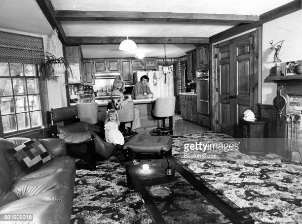 Boston Celtics John Havlicek his wife Beth and their daughter pose for a photo inside their home Dec 10 1975