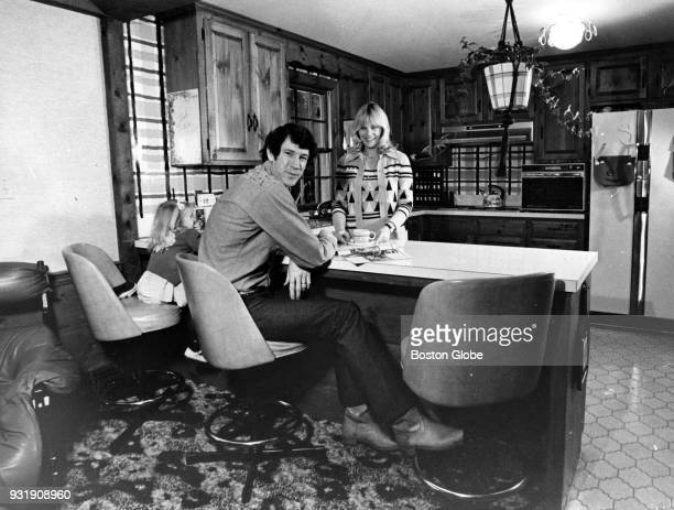 Boston Celtics John Havlicek left and his wife Beth right pose for a photo inside their home Dec 10 1975