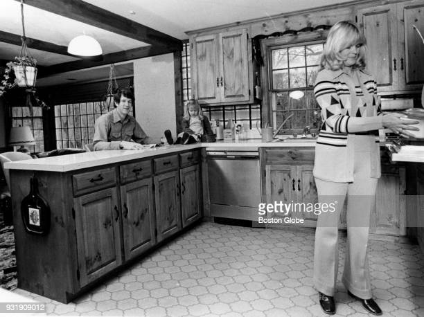 Boston Celtics John Havlicek left their daughter and his wife Beth right pose for a photo inside their home Dec 10 1975