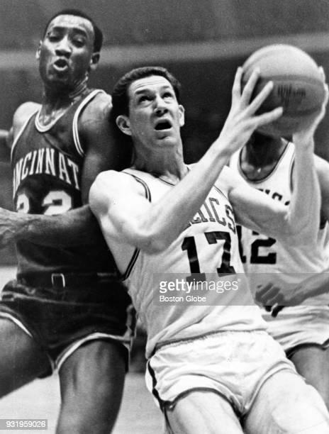 Boston Celtics John Havlicek right shoots as Cincinnati Royals Happy Hairston left attempts to block him during a game at the Boston Garden Dec 15...