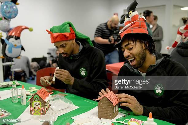 Boston Celtics Jordan Mickey and James Young build ginger bread houses for the kids at Boston Children's Hospital on December 1 2016 in Boston...
