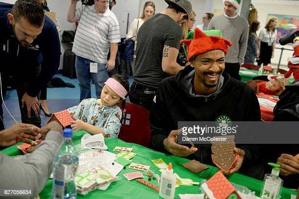 Boston Celtics Jordan Mickey builds a ginger bread house with Tiffany Boston Children's Hospital on December 1 2016 in Boston Massachusetts