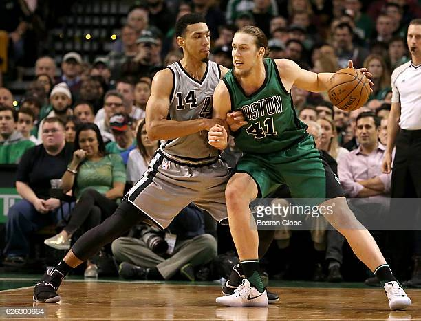 Boston Celtics Kelly Olynyk with pressure from San Antonio Spurs Danny Green during the second quarter The Boston Celtics host the San Antonio Spurs...