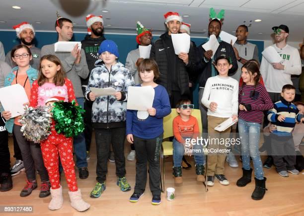 Boston Celtics Kenny Graves Brad Stevens Marcus Morris Marcus Smart Jayson Tatum Semi Ojeleye Al Horford and Gordon Hayward sing holiday carols with...