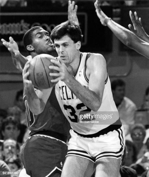 Boston Celtics Kevin McHale center shares a rebound from Washington Bullets John Williams during a game at the Boston Garden Nov 18 1988