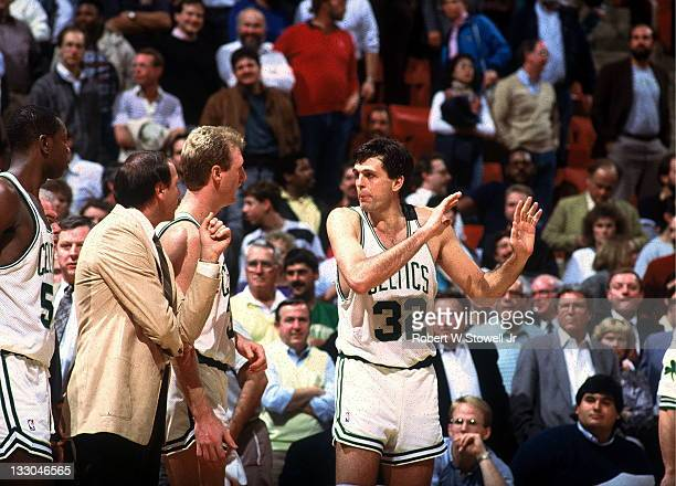 Boston Celtics Kevin McHale confers on the sideline with teammate Larry Bird Hartford CT 1992