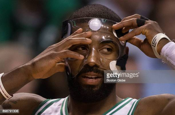 Boston Celtics' Kyrie Irving adjusts his face mask at TD Garden in Boston on Nov 27 2017 As they strive for an 18th NBA championship The Boston Globe...