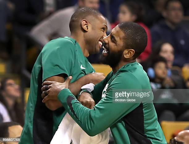 Boston Celtics' Kyrie Irving and Al Horford react from the bench to teammate Terry Rozier's slam dunk against the Chicago Bulls during the fourth...