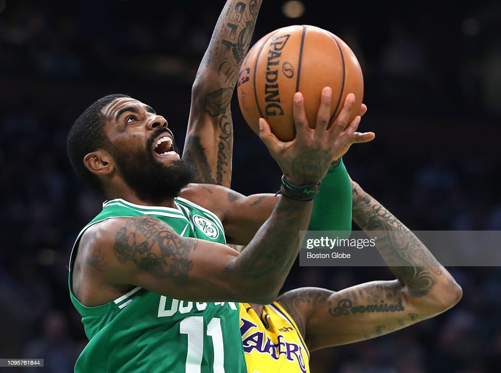 tout neuf 324f3 57acb Boston Celtics' Kyrie Irving drives to the basket past the ...