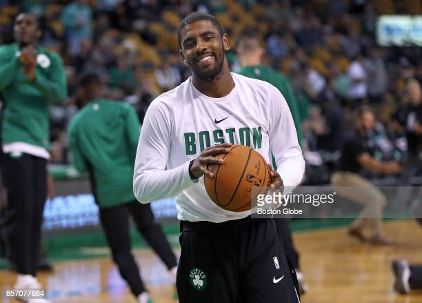 Boston Celtics' Kyrie Irving flashes a smile during pregame warmups before the opening tapoff to his first game in a Boston uniform The Boston...