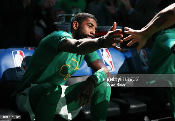 Boston Celtics' Kyrie Irving gives a hand to a teammate during pregame player introductions The Boston Celtics host the Toronto Raptors in a regular...