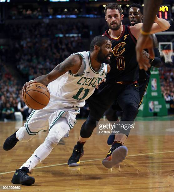 Boston Celtics' Kyrie Irving left drives on former teammate Kevin Love of the Cavaliers during the first half The Boston Celtics host the Cleveland...