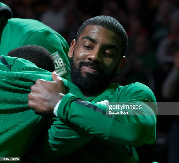 Boston Celtics' Kyrie Irving playfully bumps teammates after pregame introductions at TD Garden in Boston on Dec 6 2017 As they strive for an 18th...