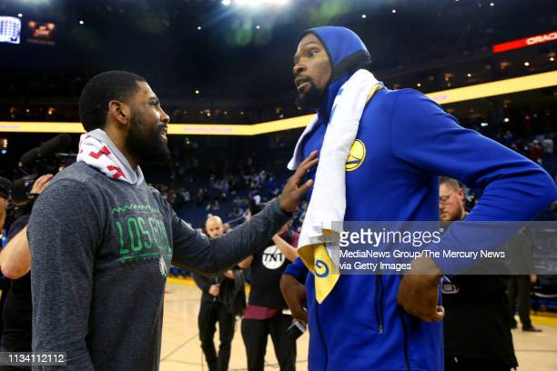 Boston Celtics' Kyrie Irving talks with Golden State Warriors' Kevin Durant after the Warriors lost12895 at Oracle Arena in Oakland Calif on Tuesday...