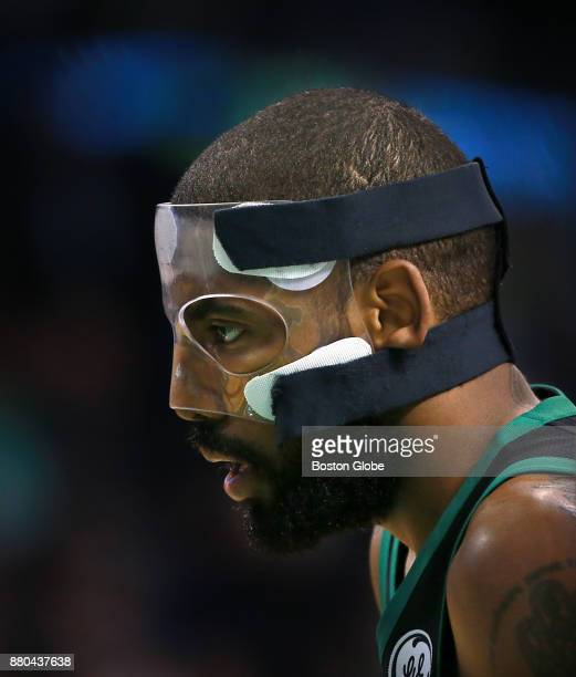 Boston Celtics' Kyrie Irving wears his face mask during the second quarter The Boston Celtics host the Orlando Magic in a regular season NBA...