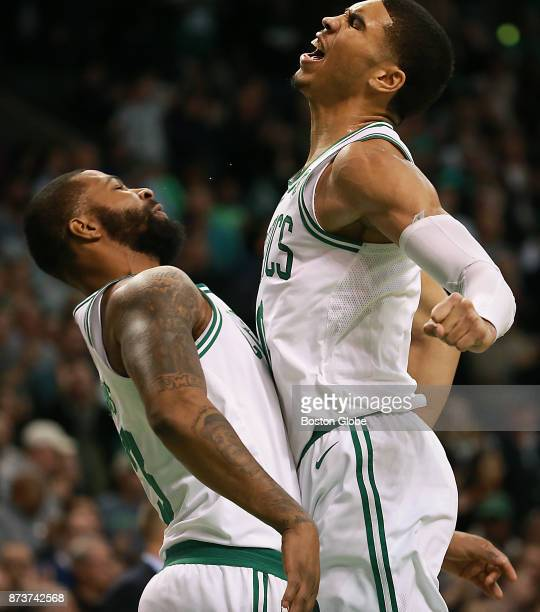 Boston Celtics' Marcus Morris chest bumps teammate Jayson Tatum as Charlotte Hornets call a time out during the fourth quarter The Boston Celtics...
