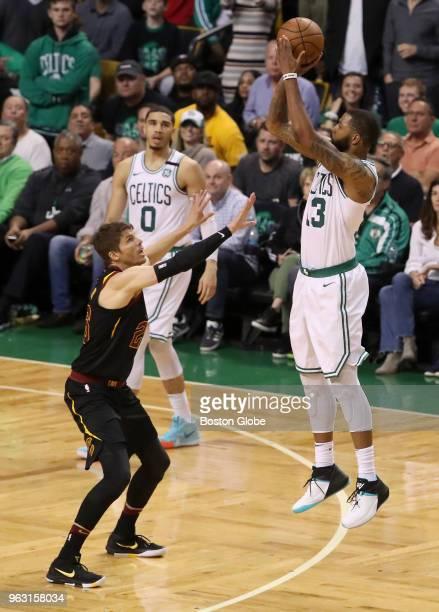 Boston Celtics Marcus Morris shots a threepoint basket over Cleveland Cavaliers Kyle Korver during fourth quarter action The Boston Celtics hosted...