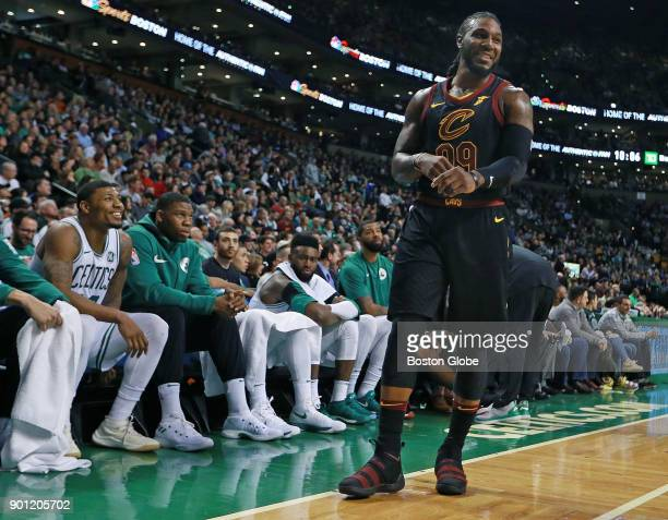 Boston Celtics' Marcus Smart bottom left jokes from the bench with former teammate Jae Crowder right of the Cavaliers during the fourth quarter The...