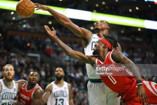 Boston Celtics Marcus Smart left gets his hand on the ball stopping a fourth quarter shot by Houston Rockets Briante Weber right during a game at the...