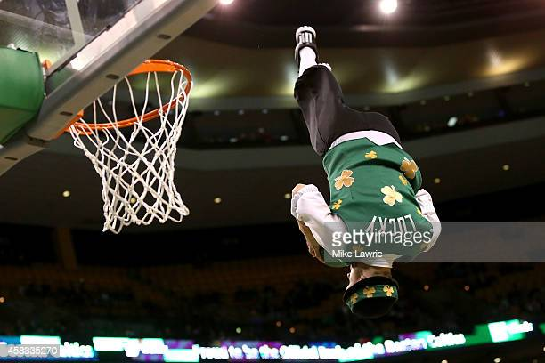 Boston Celtics mascot Lucky goes up for a dunk during a game stoppage against the Brooklyn Nets during a preseason game at TD Garden on October 22...