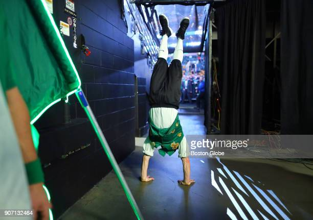 Boston Celtics mascot Lucky the Leprechaun does a hand stand in the hallway to the floor at TD Garden before the start of the game The Boston Celtics...