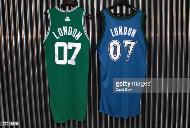 Boston Celtics Minnesota Timberwolves official London NBA basketball uniforms hang on display during a press conference for NBA Commissioner David...