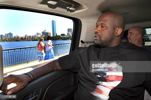 Boston Celtics newest player Shaquille O'Neal spent the day in Boston and Cambridge as he looks out at the view of the Charles River and Back Bay...