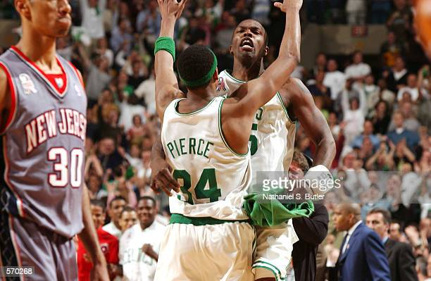 Boston Celtics Paul Pierce and Eric Williams celebrate their win over the New Jersey Nets as Kerry Kittles of the Nets passes by dejected during...