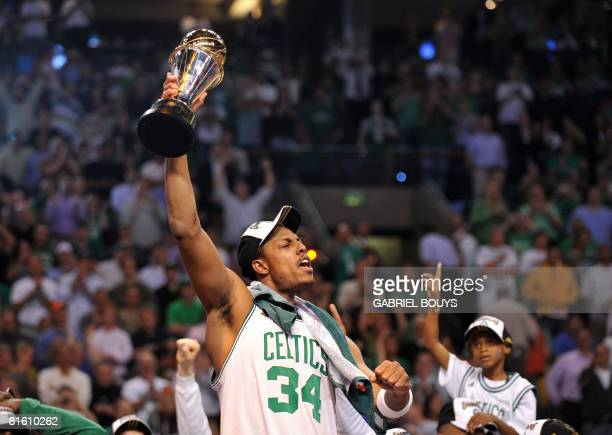 Boston Celtics' Paul Pierce celebrates with his MVP trophy after winning Game 6 of the 2008 NBA Finals in Boston Massachusetts June 17 2008 The...