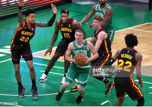 Boston Celtics' Payton Pritchard is swarmed by Hawks players as he looks for an open man in the second quarter. The Boston Celtics host the Atlanta...