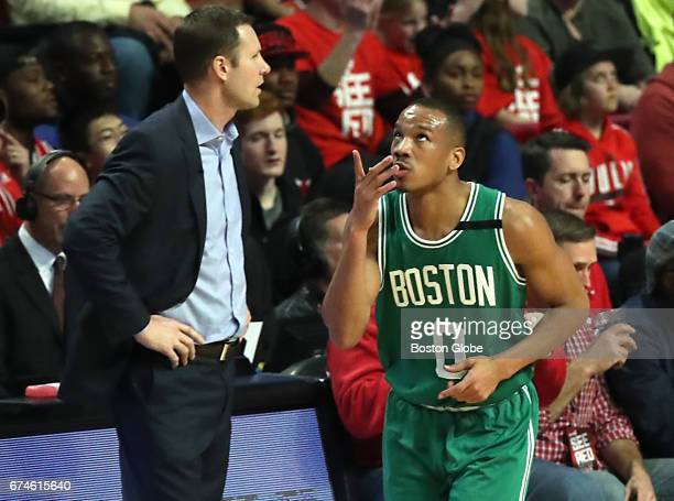 Boston Celtics player Avery Bradley points to the sky after scoring a threepoint basket in front of Chicago Bulls coach Fred Hoiberg during second...