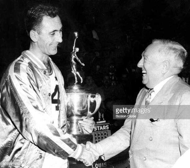 Boston Celtics player Bob Cousy, left, is presented with the Outstanding Player award from NBA President Maurice Podoloff following the NBA All-Star...