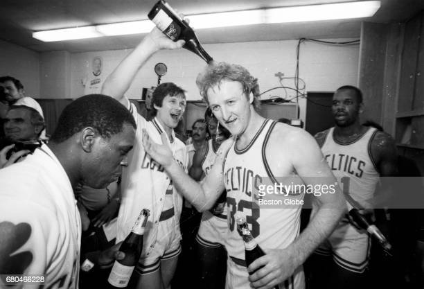 Boston Celtics player Larry Bird celebrates the team's NBA championship in the locker room after Game 7 of the NBA Finals outside of the Boston...
