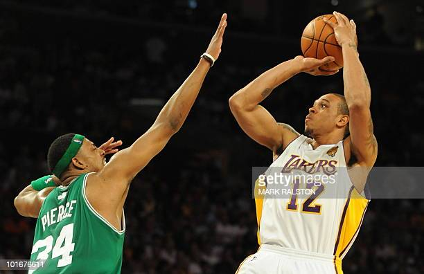 Boston Celtics player Paul Pierce tries to block LA Lakers guard Shannon Brown before Boston Celtics went on to win 103-94 in game two of the NBA...