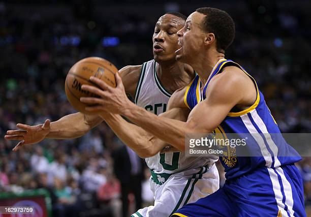 Boston Celtics point guard Avery Bradley guards Golden State Warriors point guard Stephen Curry during the third quarter as the Boston Celtics play...
