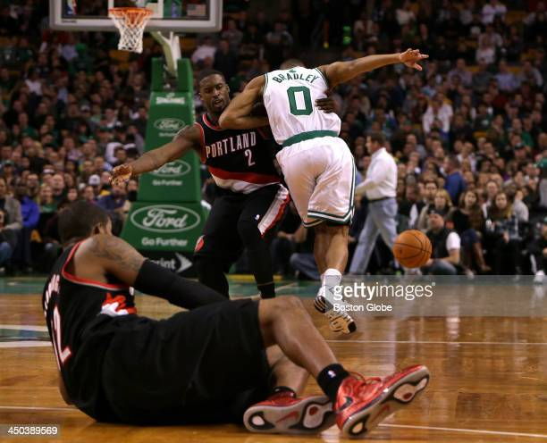 Boston Celtics point guard Avery Bradley is held up by Portland Trail Blazers shooting guard Wesley Matthews after scrambling for a loose ball in the...