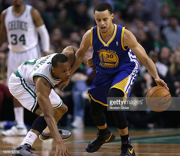 Boston Celtics point guard Avery Bradley plays up tight as he defends Golden State Warriors point guard Stephen Curry as the Boston Celtics play the...