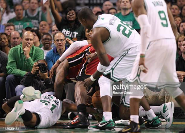 Boston Celtics point guard Keyon Dooling and Miami Heat small forward LeBron James go after the ball in the first quarter Boston Celtics NBA...