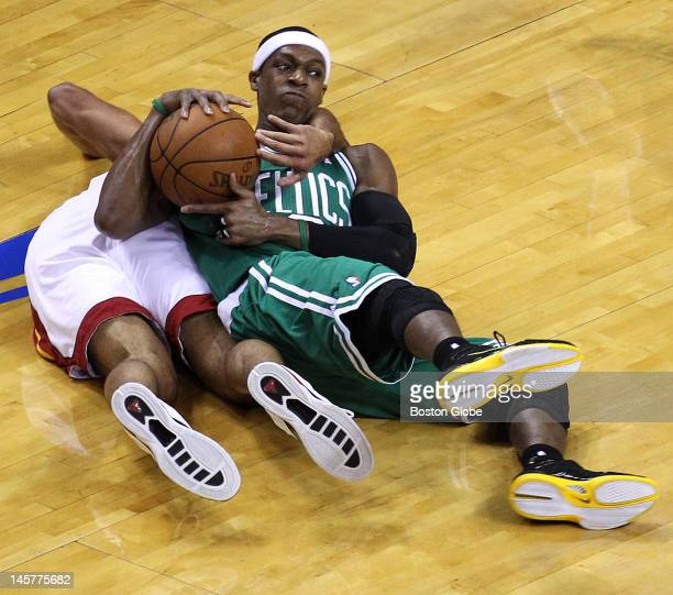 Boston Celtics point guard Rajon Rondo and Miami Heat small forward Shane Battier battle for a loose ball in the first quarter Boston Celtics NBA...