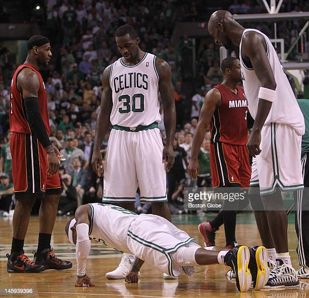 Boston Celtics point guard Rajon Rondo does pushups on the the court in the second quarter. Boston Celtics NBA basketball, action and reaction. The...