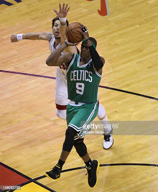 Boston Celtics point guard Rajon Rondo drives past Miami Heat shooting guard Mike Miller en route to a first quarter layup. Boston Celtics NBA...