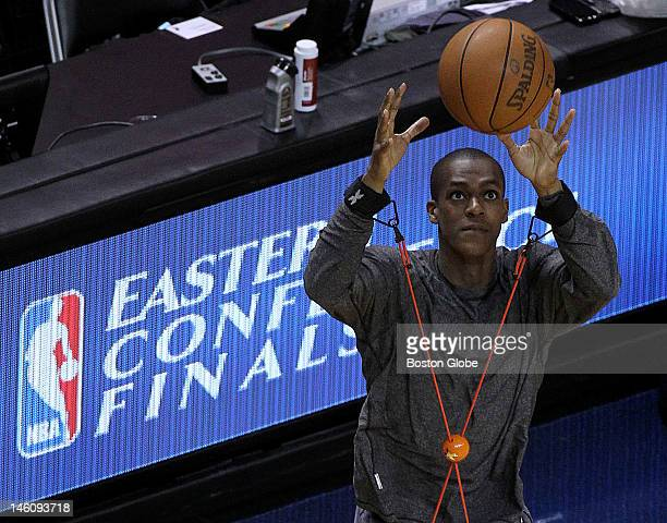 Boston Celtics point guard Rajon Rondo goes through his usual pregame stretching routine prior to the start of game seven Boston Celtics NBA...