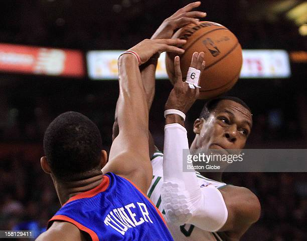 Boston Celtics point guard Rajon Rondo is fouled by Philadelphia 76ers small forward Evan Turner during the second quarter as the Celtics play the...
